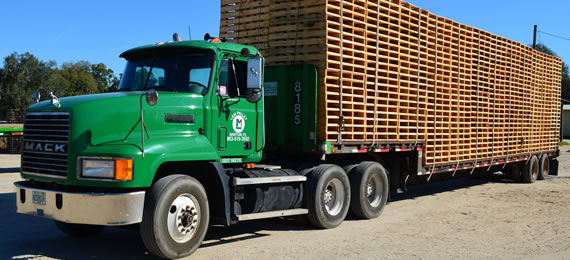 L & M Pallet Service's truck with load of pallets